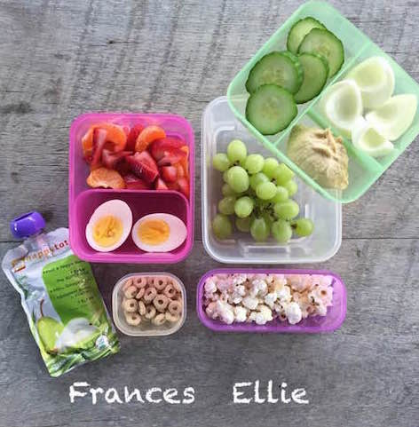 Frances: 1 boiled egg, fruit and veggie squeezie, 1/4 cup whole grain O's, 1/2 cup Halo segments and strawberries Ellie: 1 egg white, 2 Tbsp Sabra hummus, 5 cucumber slices, 1/2 cup popcorn, 1 cup grapes