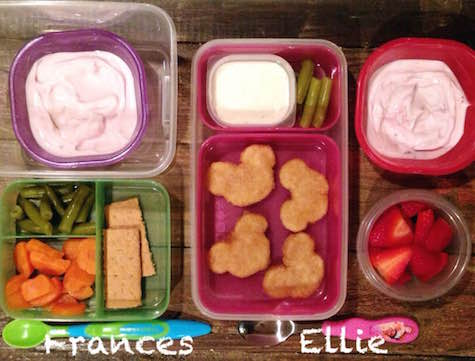 "Frances: 1/4 cup yogurt, 2 Tbsp green beans, 2 Tbsp steamed carrots, 1/2 graham crakcer Ellie: 4 whole-grain chicken breast nuggets (""Mickey Chicken""), 1 Tbsp ranch, 3 no-salt-added green beans, 1/4 cup yogurt, 1/4 cup strawberries"